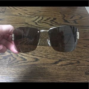 Gucci Sunglasses with gold hardware